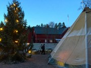 A Sami lavvu (tent) provides a spot to warm up.