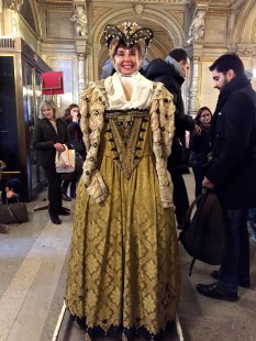 """In the lobby, visitors can """"try on"""" a costume from the Opera. Numbering in the tens of thousands, the costumes are kept across the street in a huge warehouse that is connected to the opera by an underground tunnel (so performers can scurry unseen onsite.)"""