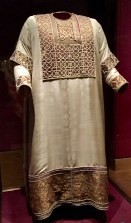 """Called the """"Alba"""" for its white color, this coronation robe dates to the 13th century on the outside. However, tests have shown that it covers older garments layered inside. One of these may date back to the 9th century -- perhaps during the reign of Charlemagne."""