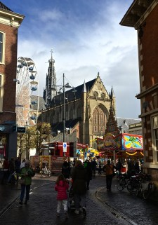 Here, you can see that the Grote Kerk (Great Church) dominates the Grote Markt (Great Market, i.e. Market Square). A funfair fills the marketplace in honor of the flower festival. This square has been the center of Haarlem's community events for more than 700 years. If you look at Dutch Master paintings of it, you'll see it hasn't changed much (except for the Ferris wheel and modern rides, of course.)