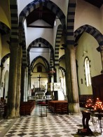 The pretty church interior contains a wooden crucifix that, on Corpus Domini six days after Easter, gets carried down to the harbor for a service. The black-and-white striped lancet arches are typical for Ligurian Gothic architecture.