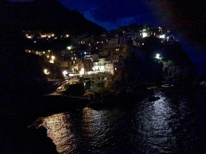 The sky over Manarola shows the fading flash from a bolt of lightening from the storm out at sea.