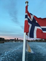 How 'bout that scenic skyline? In the background, you can see the twin towers of City Hall, and beneath the flag, are the stone walls of Akershus Fortress.