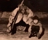 Satchmo poses with one of the littlest skiers.