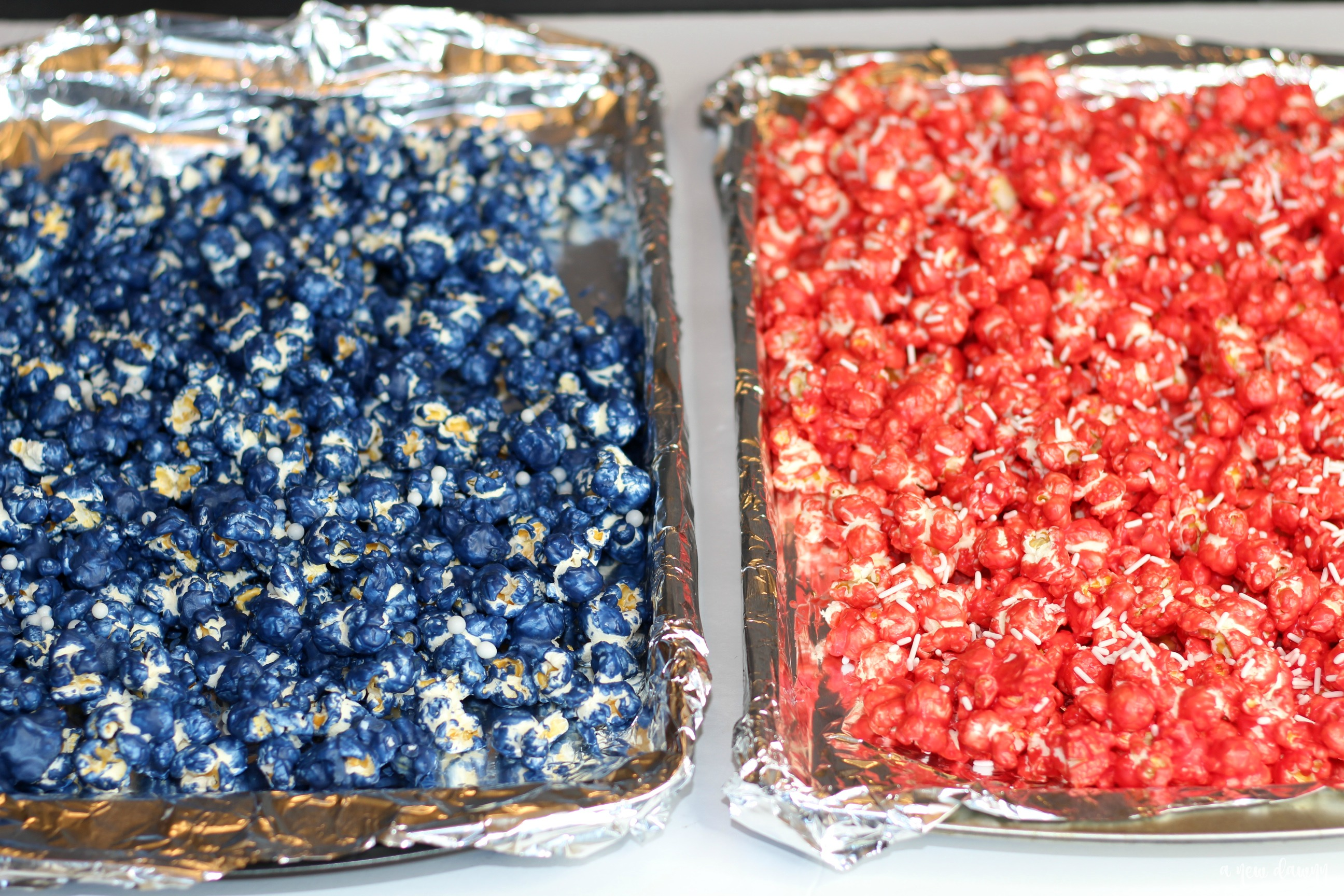 red and blue popcorn on a tray