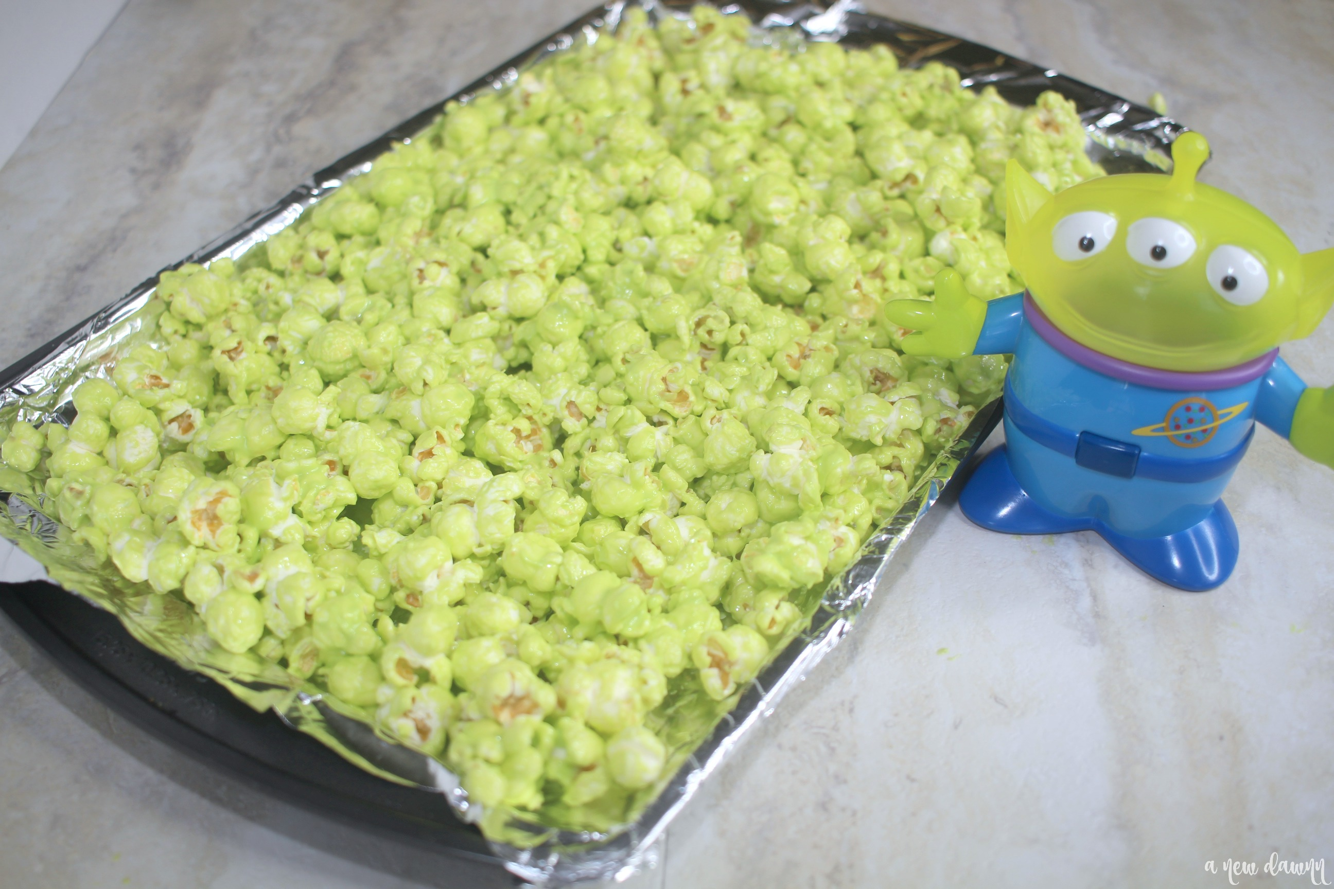 green popcorn on a cookie sheet