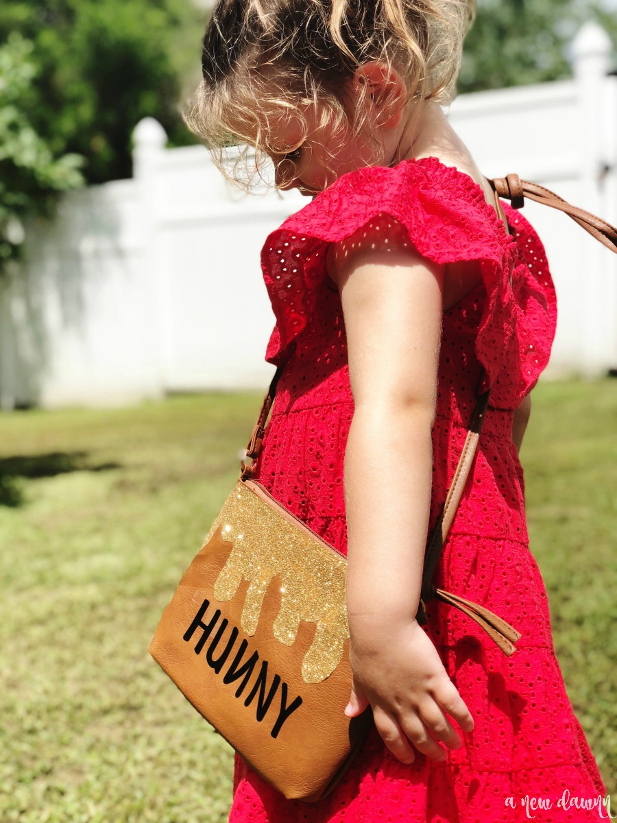 girl wearing hunny pot purse
