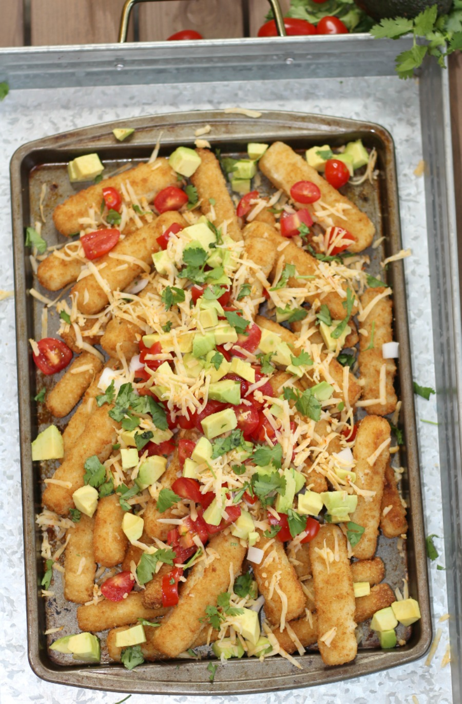 This is not your ordinary nachos recipe! These Fish Stick Nachos are a delicious twist on dinner!