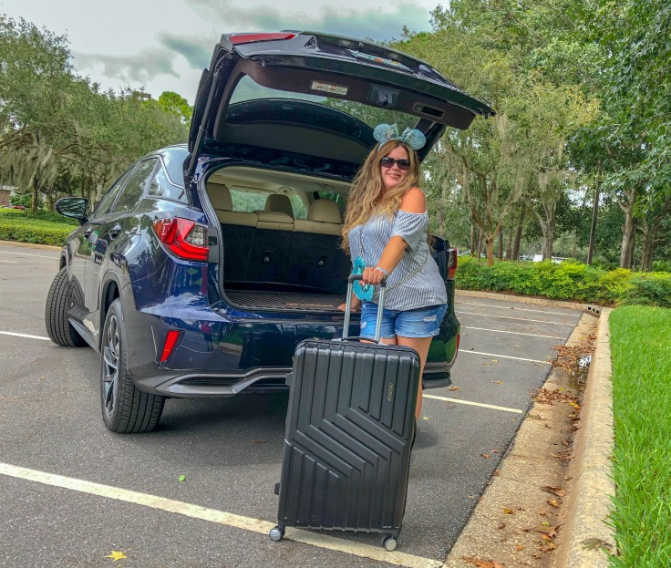 Girl with suitcase by Lexus RX 450