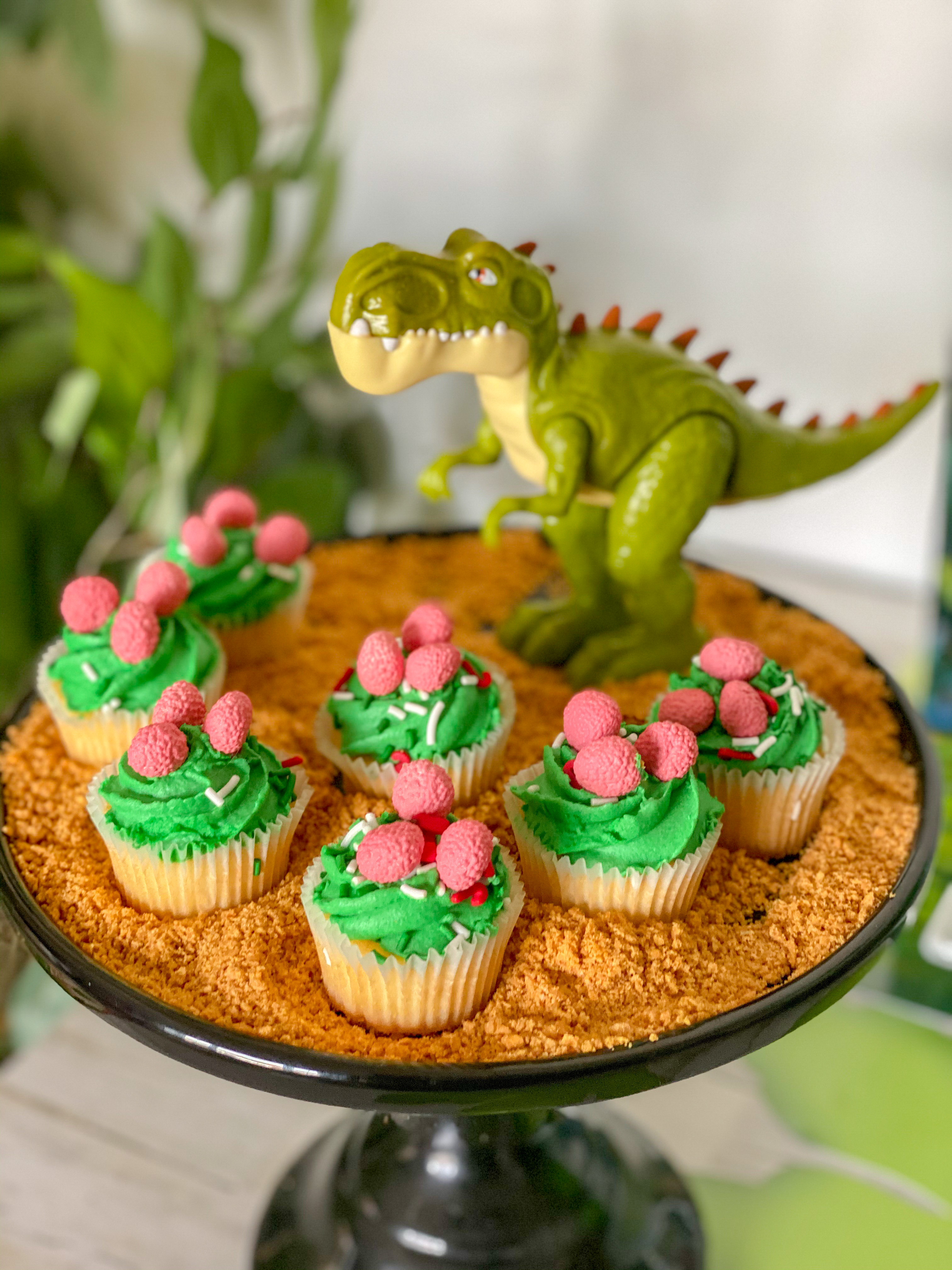 toy dino with Dino egg cupcakes