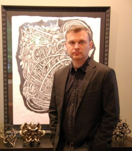 Joshua Harker in front of one of his Tangle drawings
