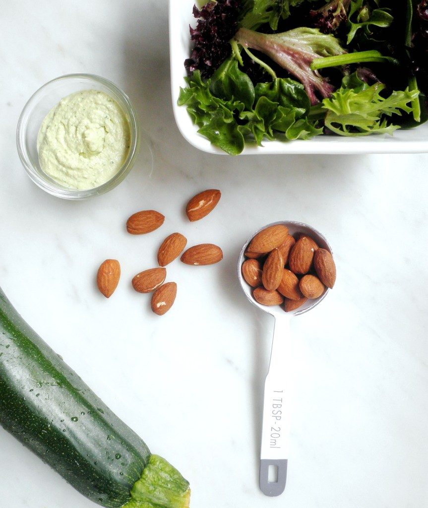Almonds, zucchini, dressing, and mix lettuce