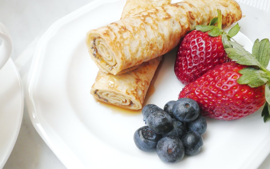 Breakfast crepes with berries and tea