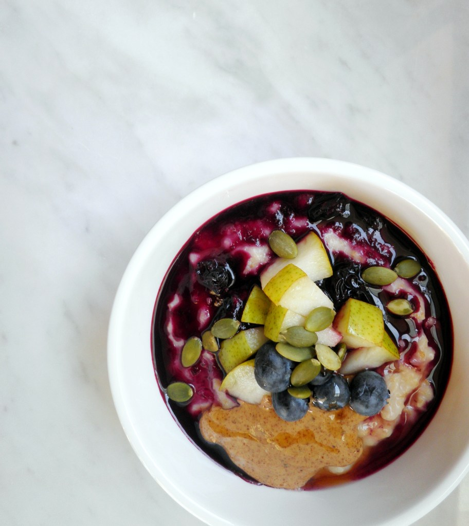 Rice milk porridge with almond butter and pears