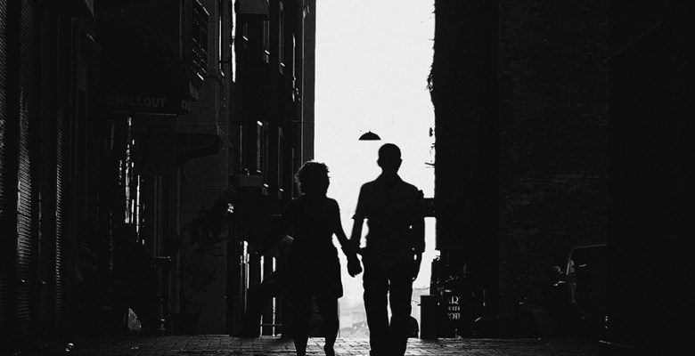 photo-of-man-and-woman-walking-in-alley-2020312