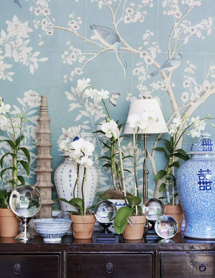Vignette with blue Chinoiserie wallpaper and ginger jars by Mark D. Sikes