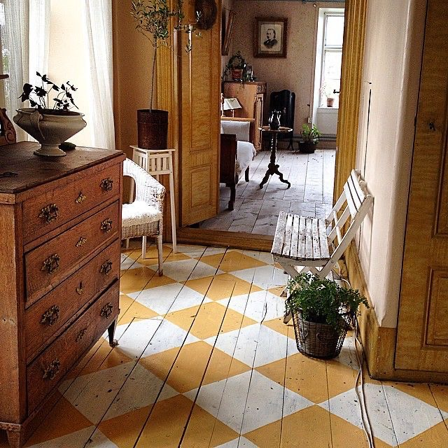 Entryway with checkerboard wood floor