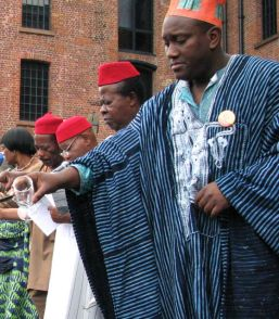 Assembled chiefs pour the libation