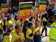 Children lead Walk of Remembrance towards the Pier Head where slaves ships once docked