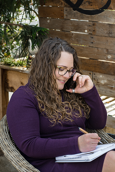 Brand Strategist on phone with virtual assistant client