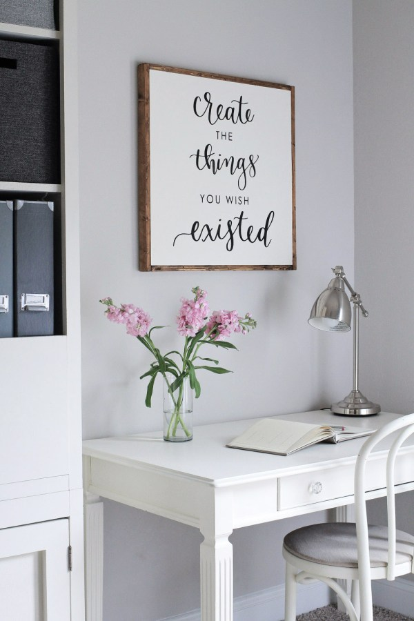 DIY Wood Sign with Calligraphy Quote above desk on office wall