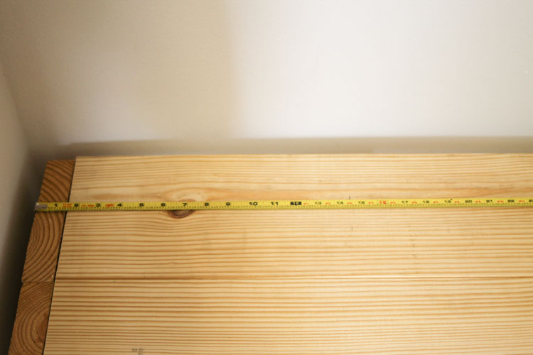 measuring the center point on bench top for cubby divider