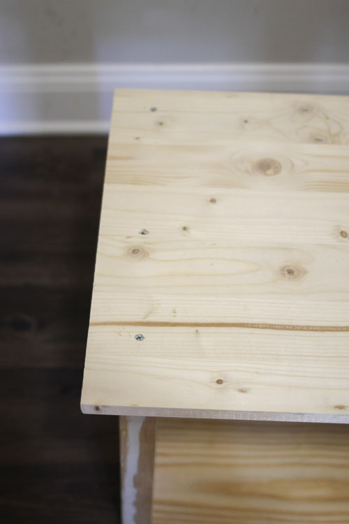 DIY hall tree bench seat attached to the bench frame with three wood screws