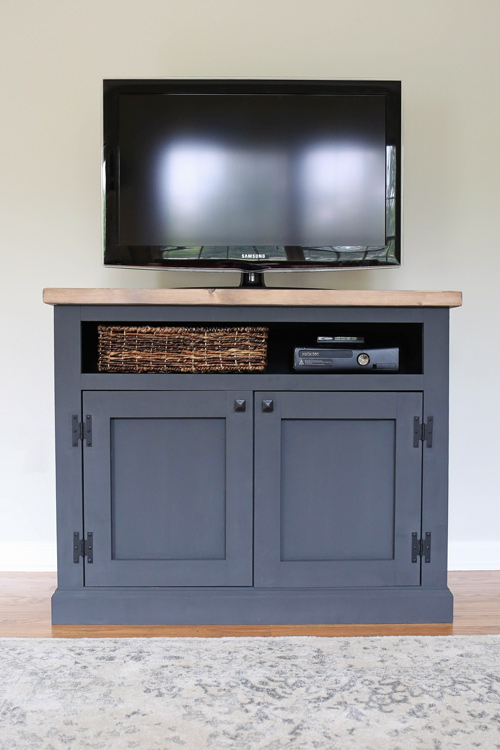 TV in living room on a DIY Rustic TV Stand Media Console