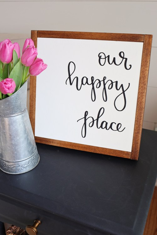Our Happy Place DIY Wood Sign with pink tulips on black side table