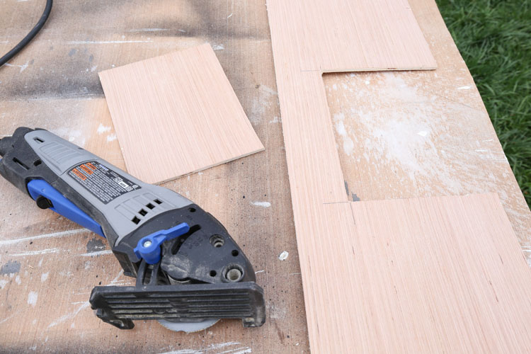 An opening cut out of shiplap board for ceiling vent and a dremel tool
