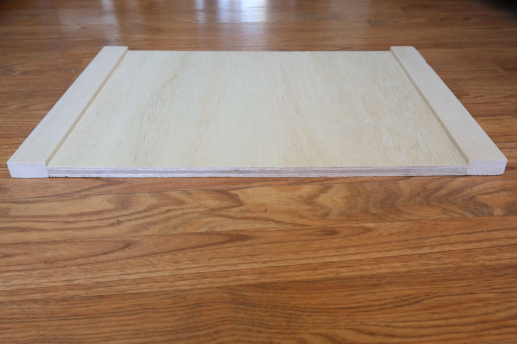 plywood side board with two 1x2 boards attached on each side