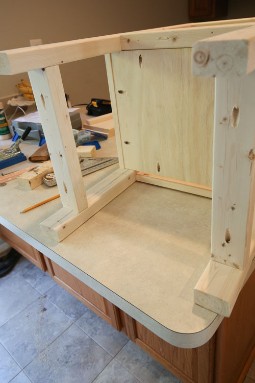 Add bottom shelf rack to bathroom vanity