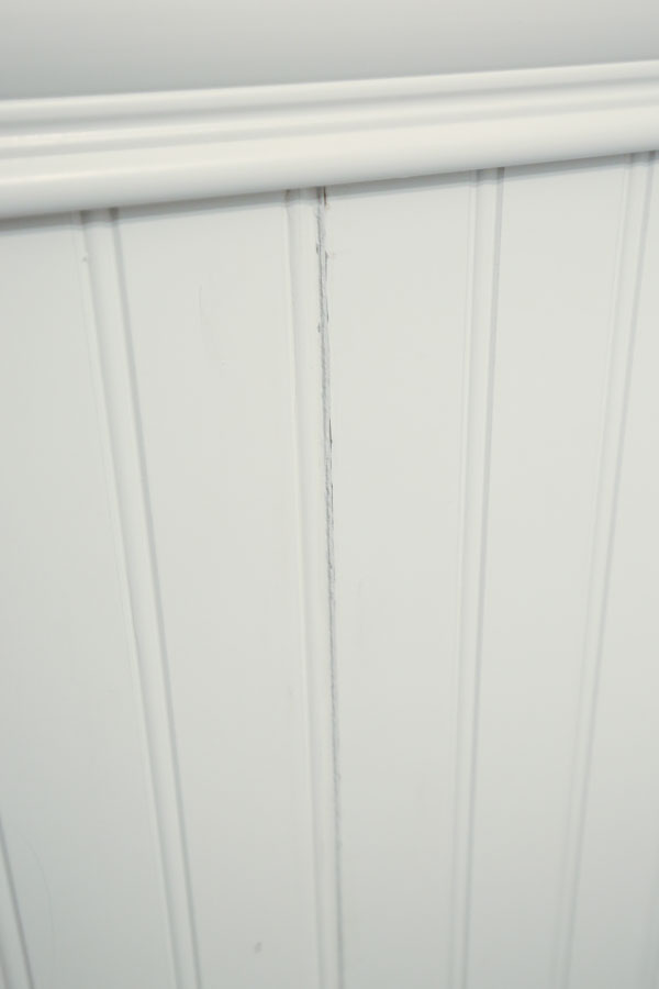 two beadboard panels connected with a caulked crack