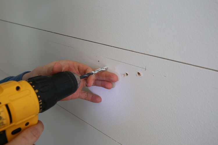 drilling pilot holes on wall for floating shelf brackets