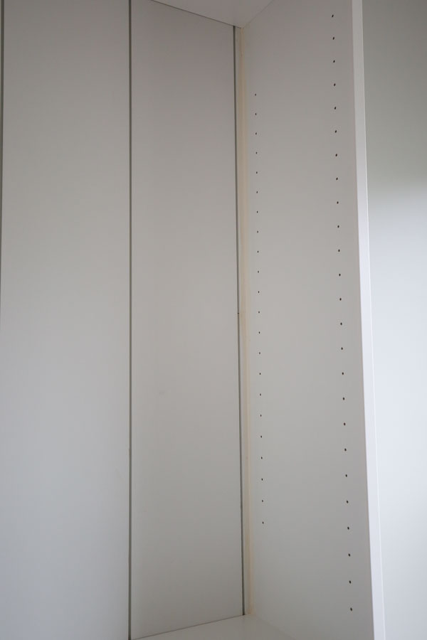 caulking the gap on bookcase edge from shiplap board