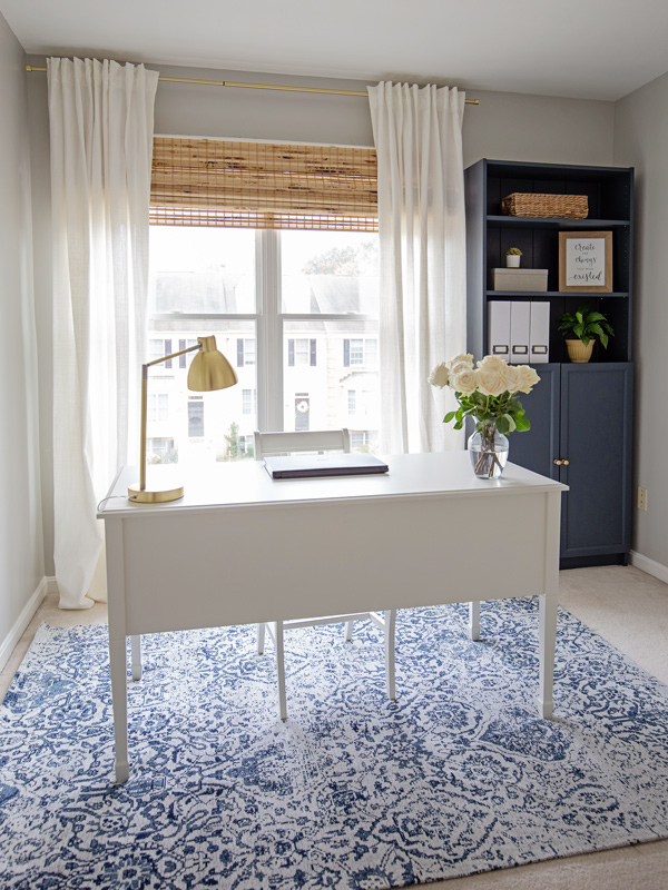 White desk in a navy and grey home office makeover