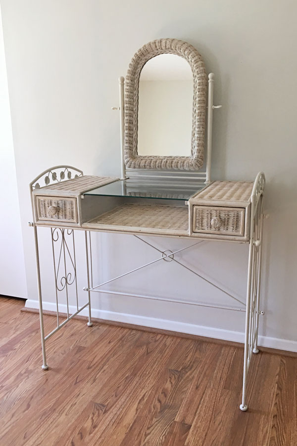 Old, white wicker vanity that inspirted this new makeup vanity build