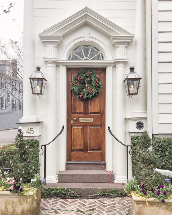 Christmas wreath with berries on wood door in Charleston for Christmas decor