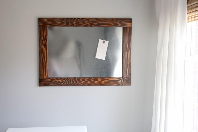 Wood framed DIY magnetic board in office
