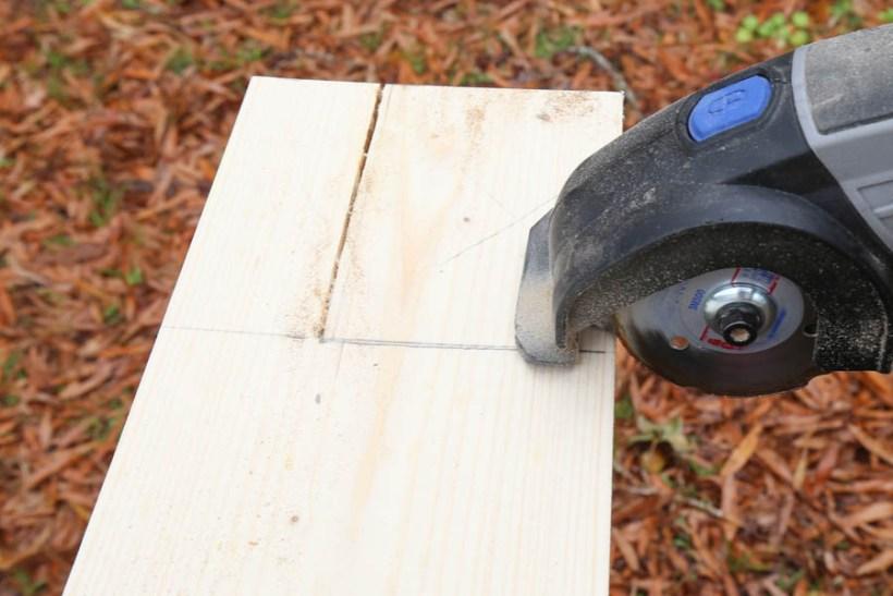 cutting new window sill edges with Dremel tool for DIY window trim
