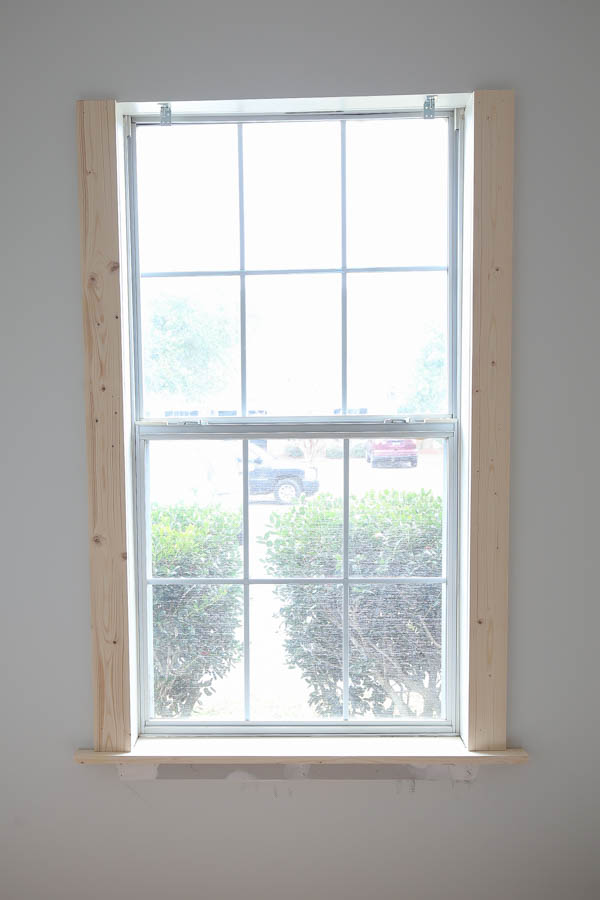 Add the 1x4 DIY window trim to the window sides