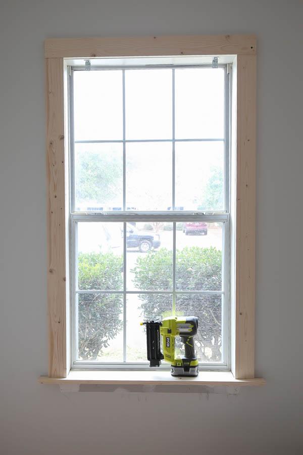 Add the 1x4 DIY window trim to the window top