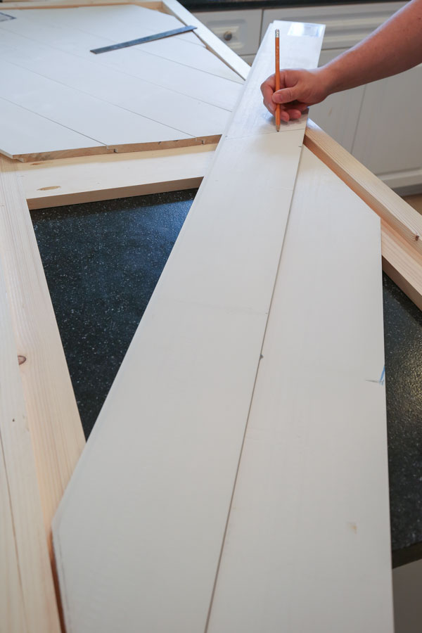 installing second shiplap board for barn door entertainment center DIY