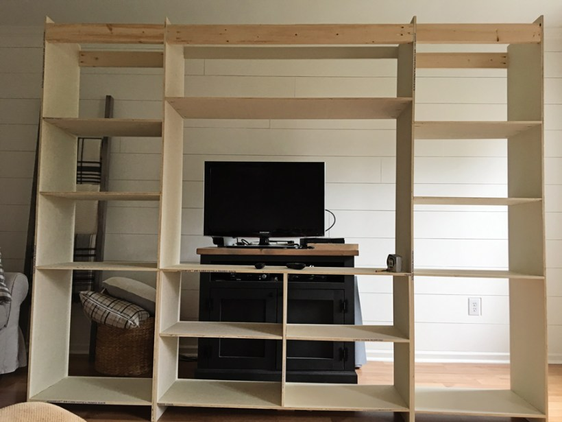 beginning to build to the barn door entertainment center with plywood