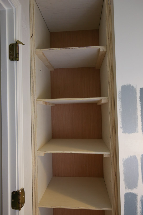 Add 1x2 wood braces under plywood shelves with brad nails