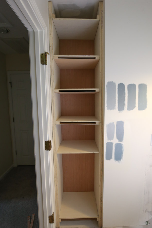 "Attach 1/4"" plywood to 1x2 wood braces on shelves to create the bottom of the shelf"