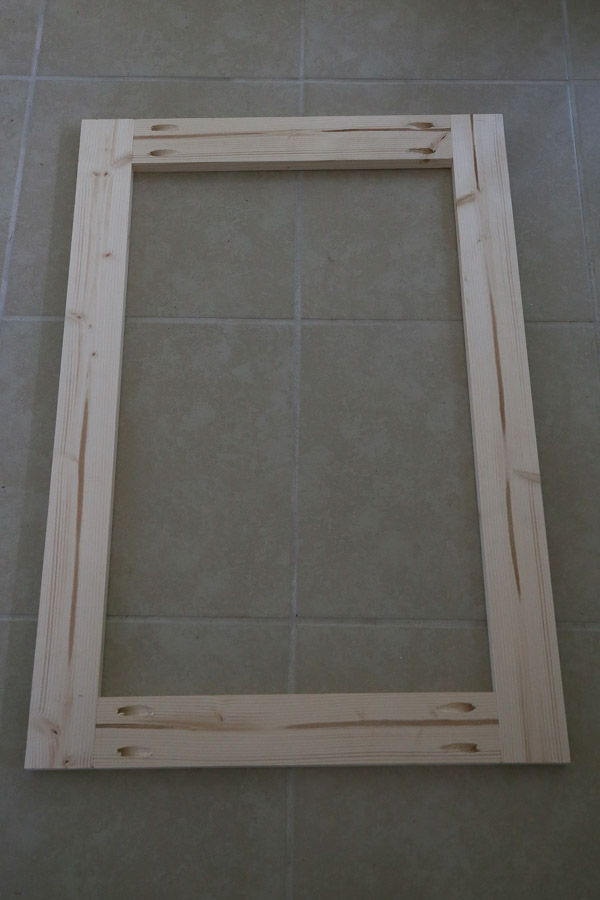 Build the door frame of the DIY built in cabinet door with 1x3s and attach with pocket holes and Kreg screws