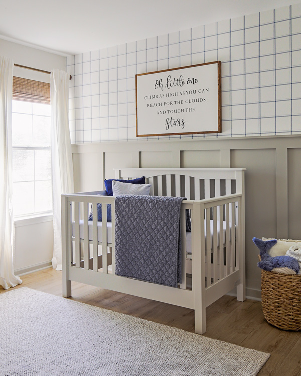 nursery accent wall with blue and grey nursery decor