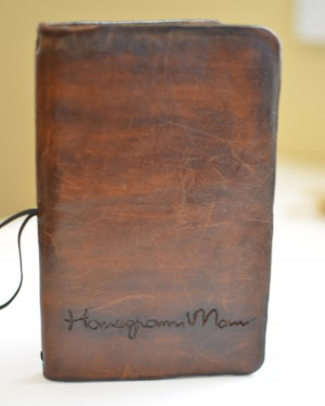 My purse notebook. My husband made this leather cover for my notebooks and engraved Homegrown Mom on it. I like him.