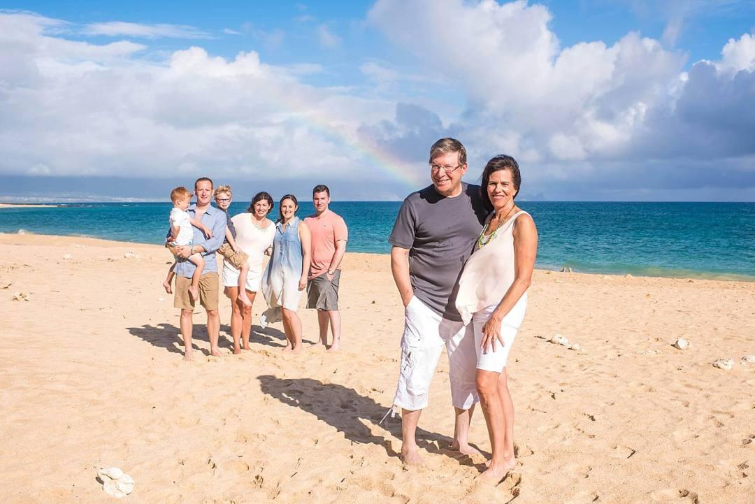 Family with rainbow on the beach in Maui, hawaii